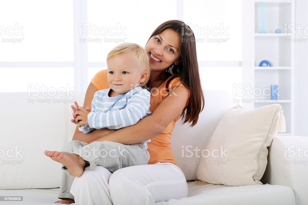 Mother resting in living room with her son. royalty-free stock photo