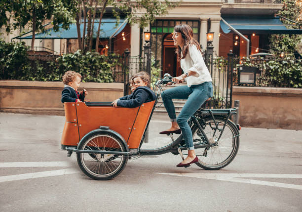 Mother riding bicycle stock photo