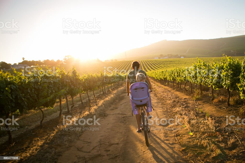 Mother riding with her son stock photo