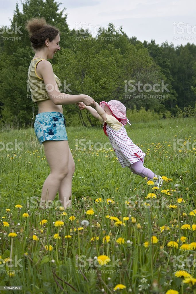 mother rotate baby royalty-free stock photo
