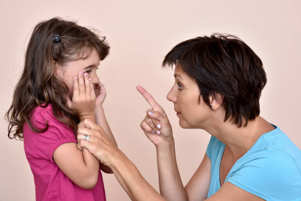Mother scolding a daughter Angry mother scolding a scared daughter scolding stock pictures, royalty-free photos & images