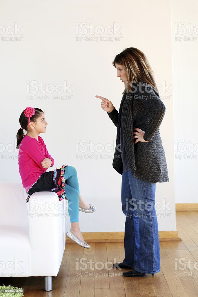Mother scolding daughter stock photo