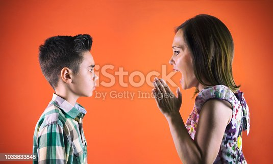 istock Mother scolding her teenage child 1033833848