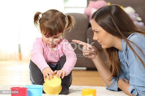 istock Mother scolding to her baby daughter 805044004