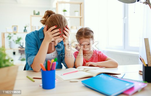 istock mother scolds a child for poor schooling  and homework 1162219656