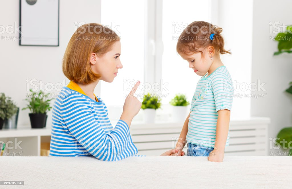 Mother scolds and punishes child daughter stock photo