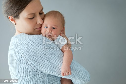 Close-up of a Mother and her New Born Baby Boy Cheek to Cheek