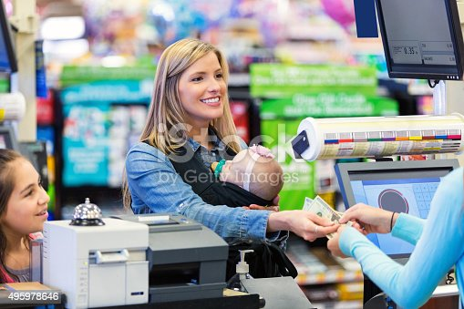 istock Mother shopping with daughter and baby in grocery store 495978646