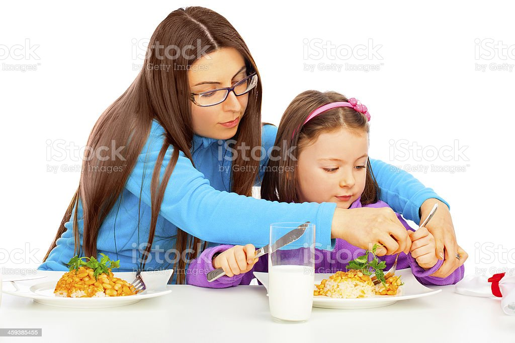Mother showing Cutlery stock photo