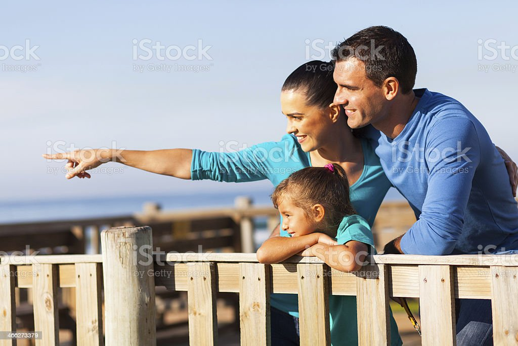 mother showing her family something royalty-free stock photo