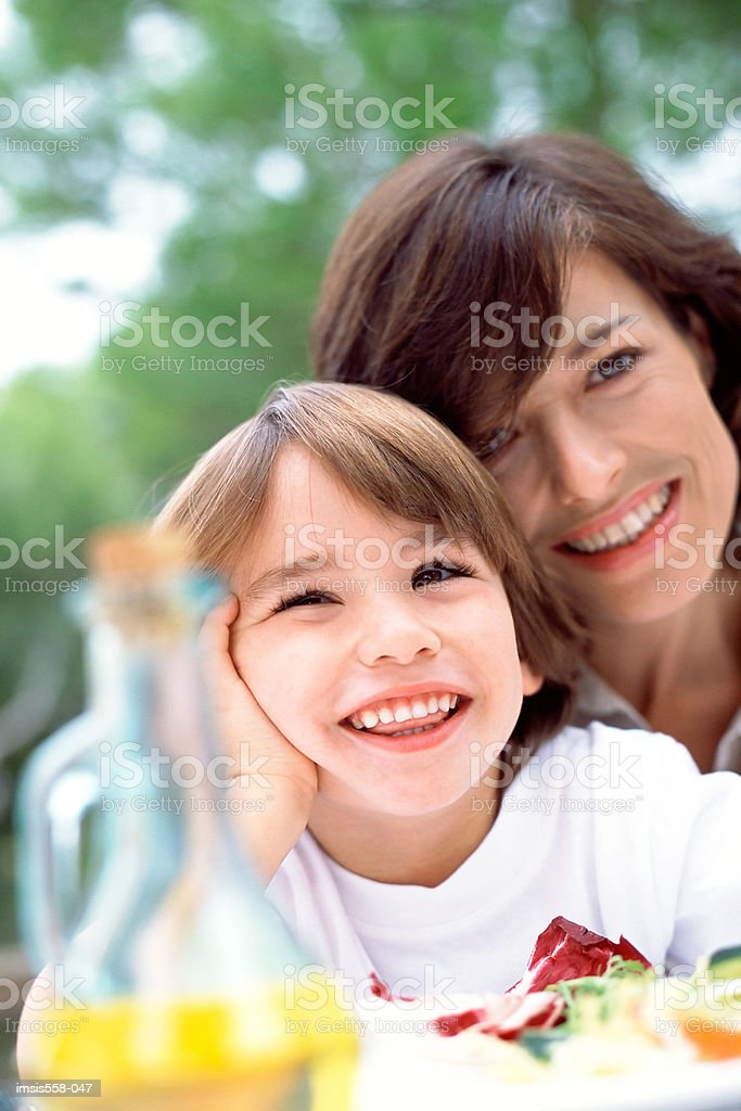 Mother son at lunch outdoors royalty-free stock photo
