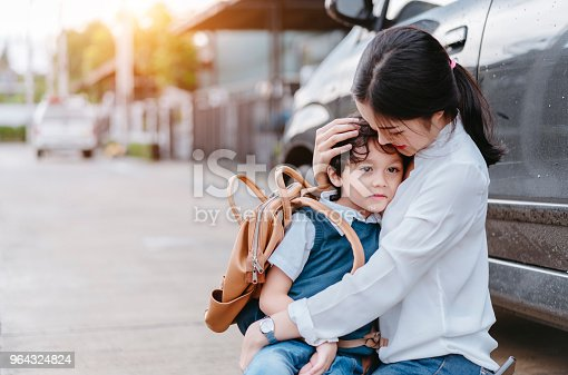 istock Mother soothe a son crying and sending to school, Parent and pupil going to kindergarten of preschool first day back to school concept. 964324824