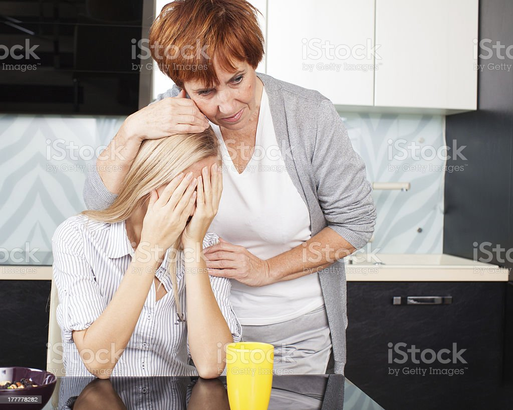 Mother soothes sad daughter Mother soothes sad daughter. Mature woman calm young woman Adult Stock Photo