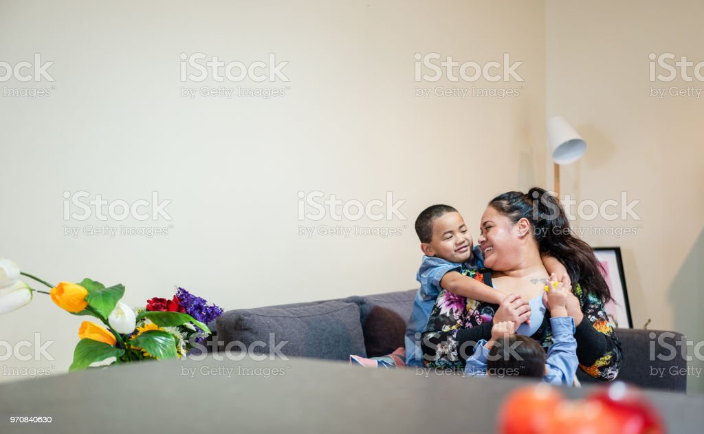 Mother spending quality time with kids at home. stock photo