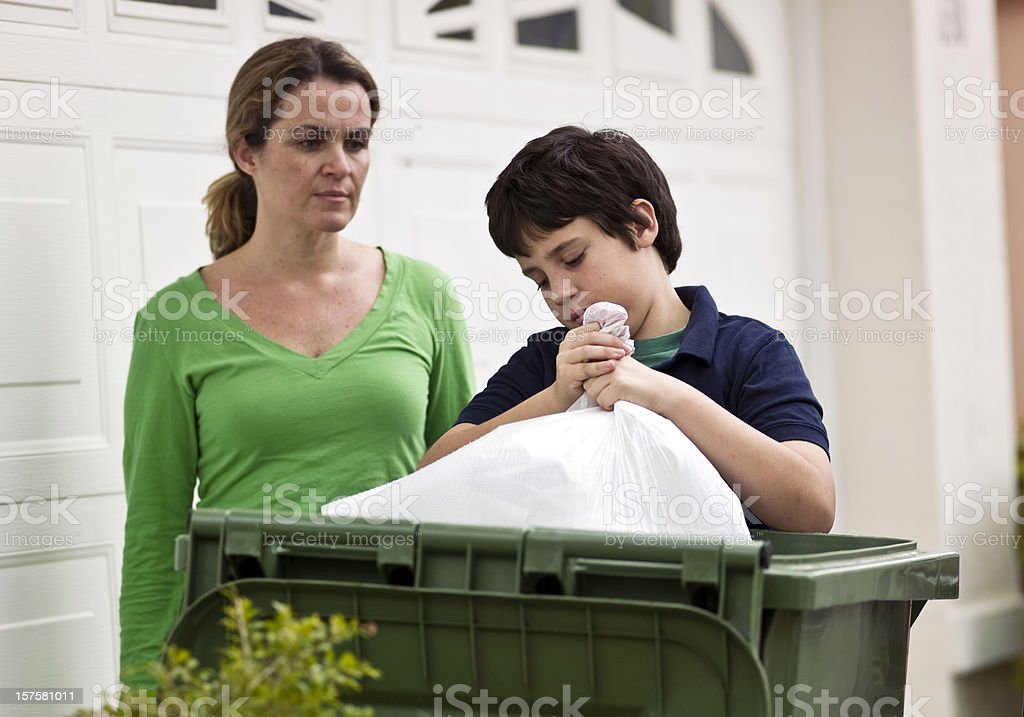Mother supervising her sons chores royalty-free stock photo
