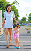 istock Mother take care her daughter child girl. 850579974