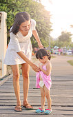 istock Mother take care her daughter child girl. 850581446
