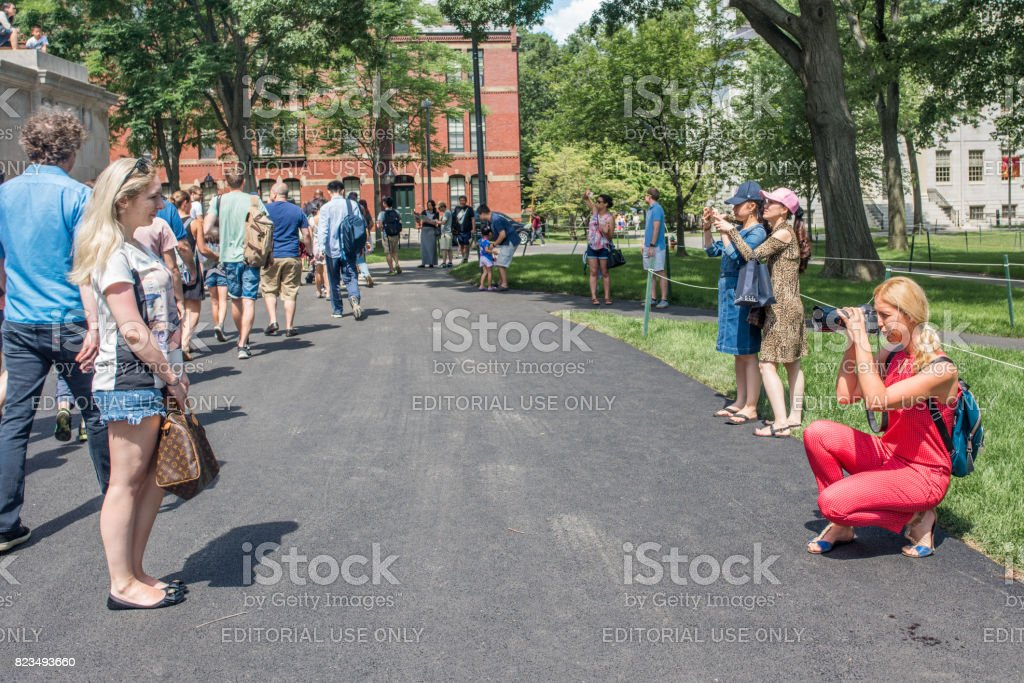 Mother taking a photo of her daughter on the Harvard University campus stock photo