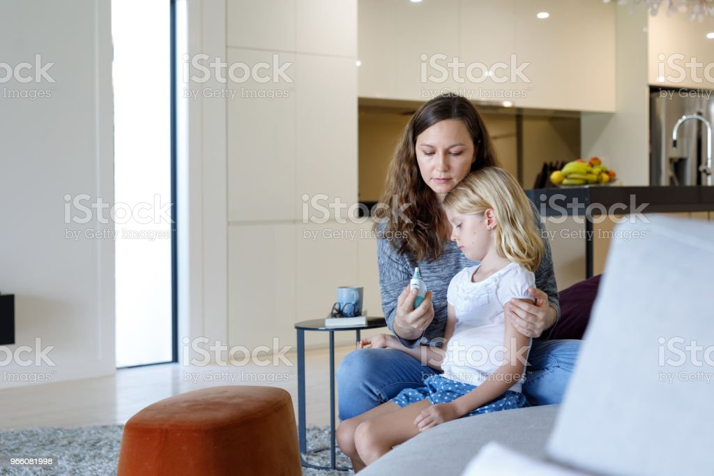 Mother Taking Child's Temperature With Thermometer - Royalty-free 6-7 Years Stock Photo