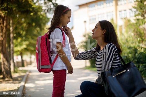 istock Mother taking daughter to school 1041984920