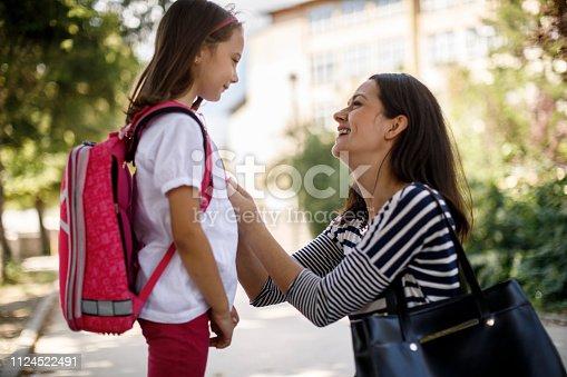 istock Mother taking daughter to school 1124522491