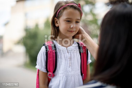 istock Mother taking daughter to school 1124522762