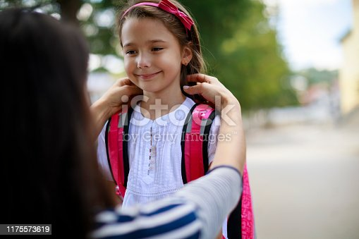 istock Mother taking daughter to school 1175573619