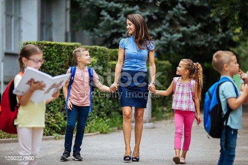 Mother taking her children to school