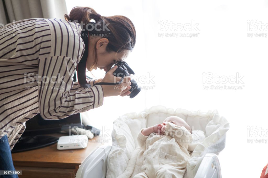 Mother taking pictures of babies. royalty-free stock photo