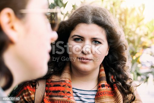 Mother talking to upset daughter.