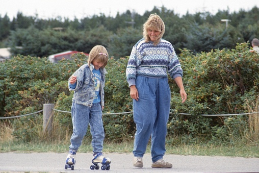 Schleswig Holstein, Germany, 1985. Mother teaches her daughter to roller-skate.