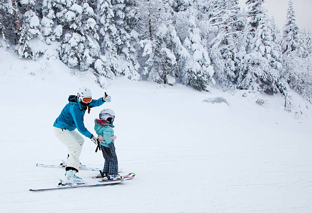 Mother Teaching Daugther to Ski at Mont-Tremblant Resort, Qu stock photo