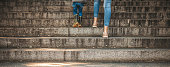 istock Mother teaching her boy to climb stairs 1213296306
