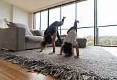 istock Mother teaching her son how to make a handstand at home 1261687198