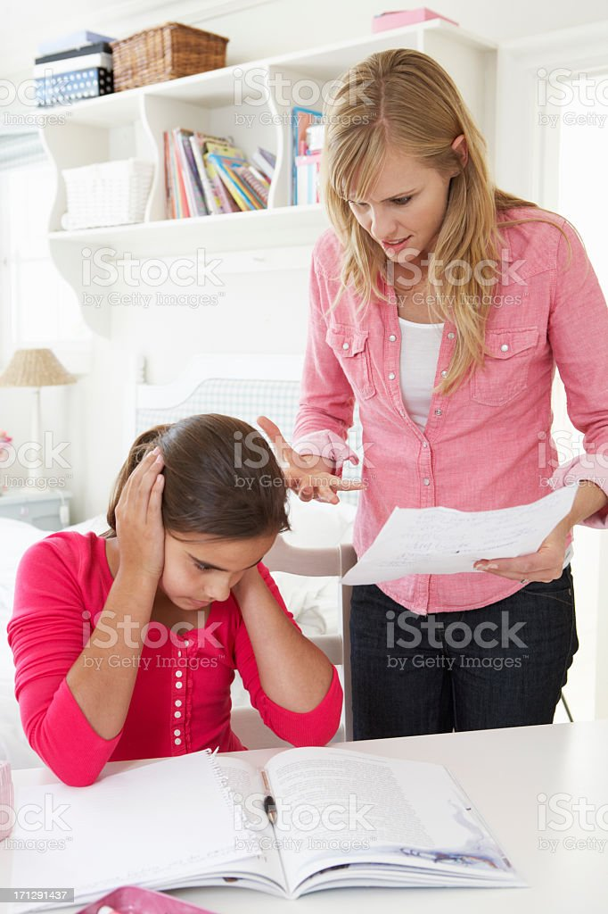Mother Telling Daughter Off For Bad School Report stock photo