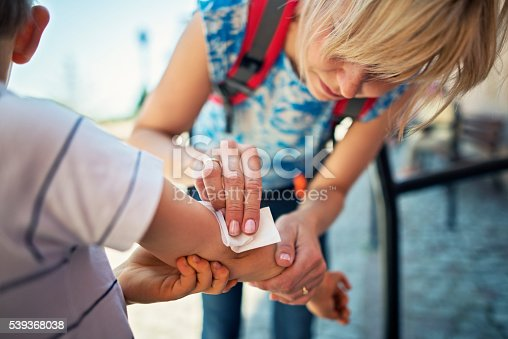 istock Mother tending to her son's wounded arm 539368038