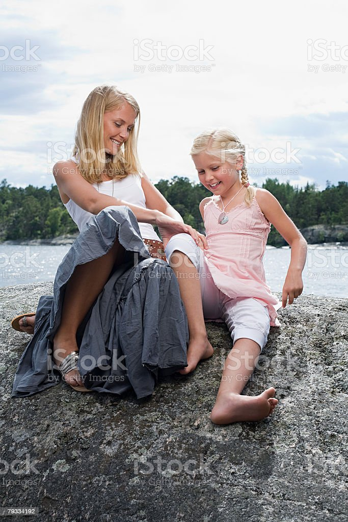 Mother tickling daughter 免版稅 stock photo