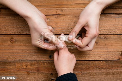istock Mother to use a bandage to the child's finger 931599680