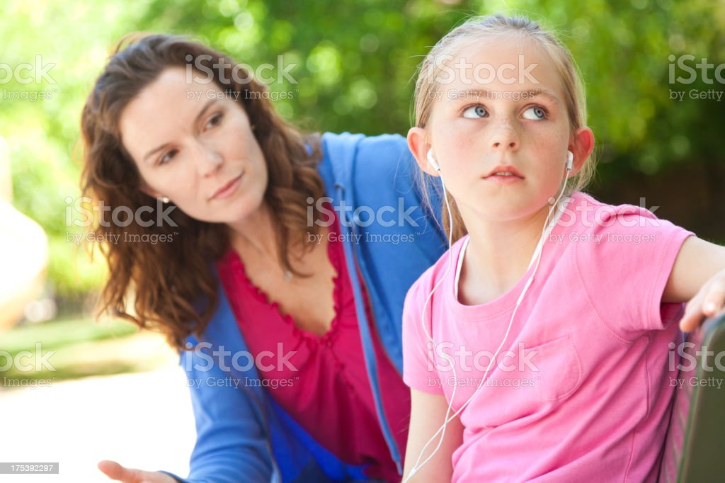 Mother trying to talk with her upset daughter royalty-free stock photo