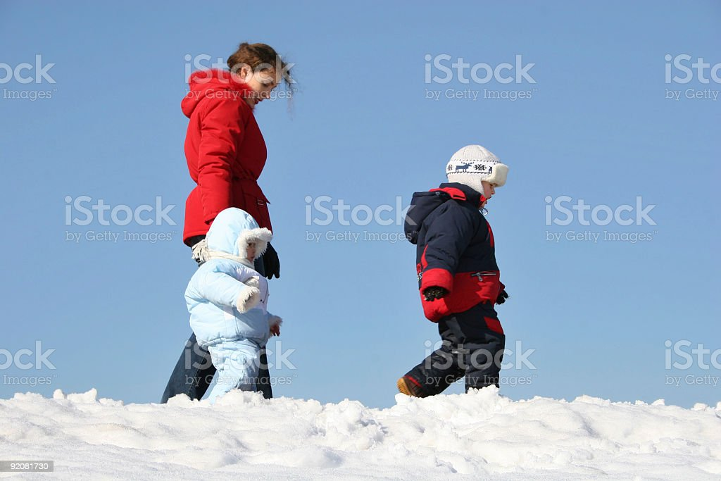 mother walk with children. winter. royalty-free stock photo