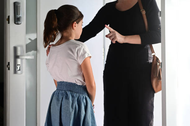 Mother warning her daughter how to behave before she live home stock photo