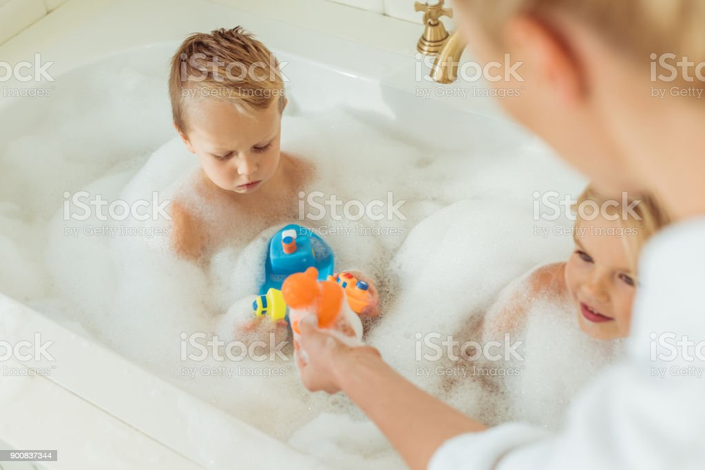 Mother Washing Kids In Bathtub Stock Photo & More Pictures of Adult ...