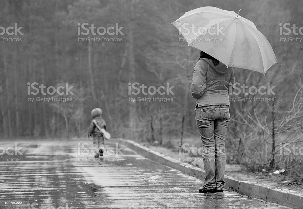 Mother watches as her son goes away stock photo