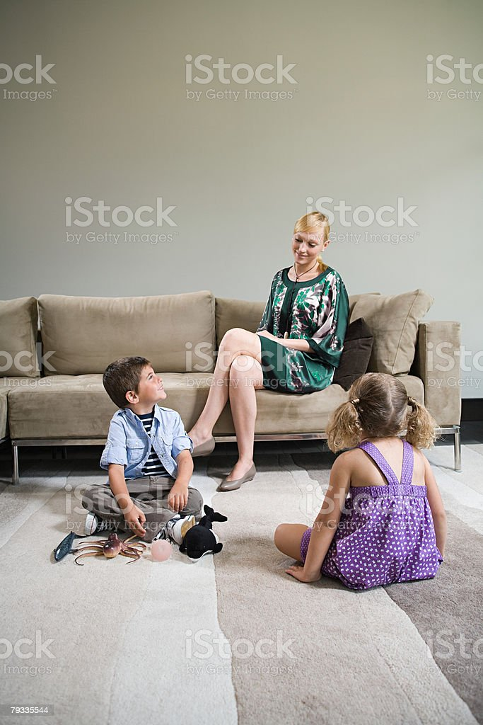 A mother watching her children play 免版稅 stock photo