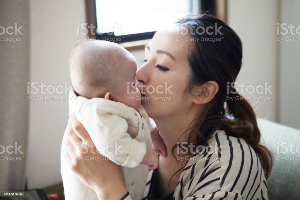 Mother who kisses baby. royalty-free stock photo