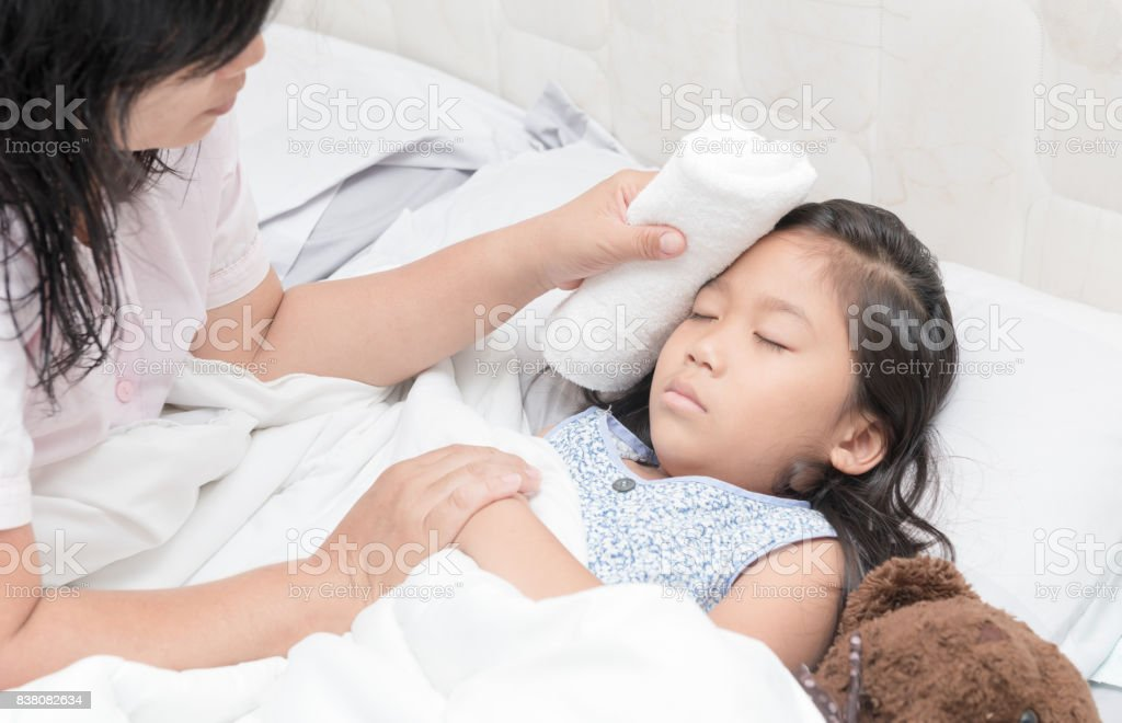 Mother wiped daughter's body to reduce fever - Royalty-free Asia Stock Photo
