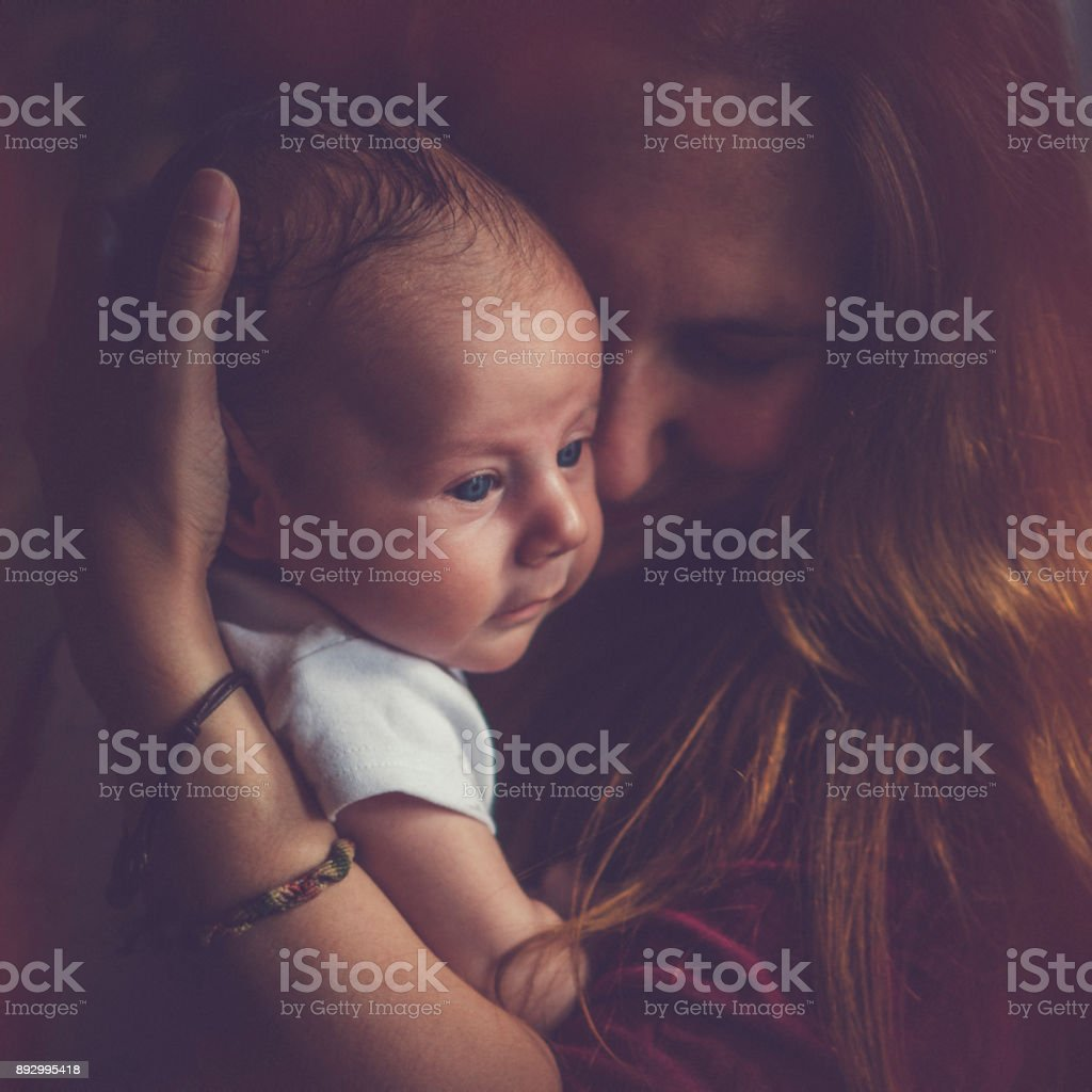 Mother with 2 months baby stock photo