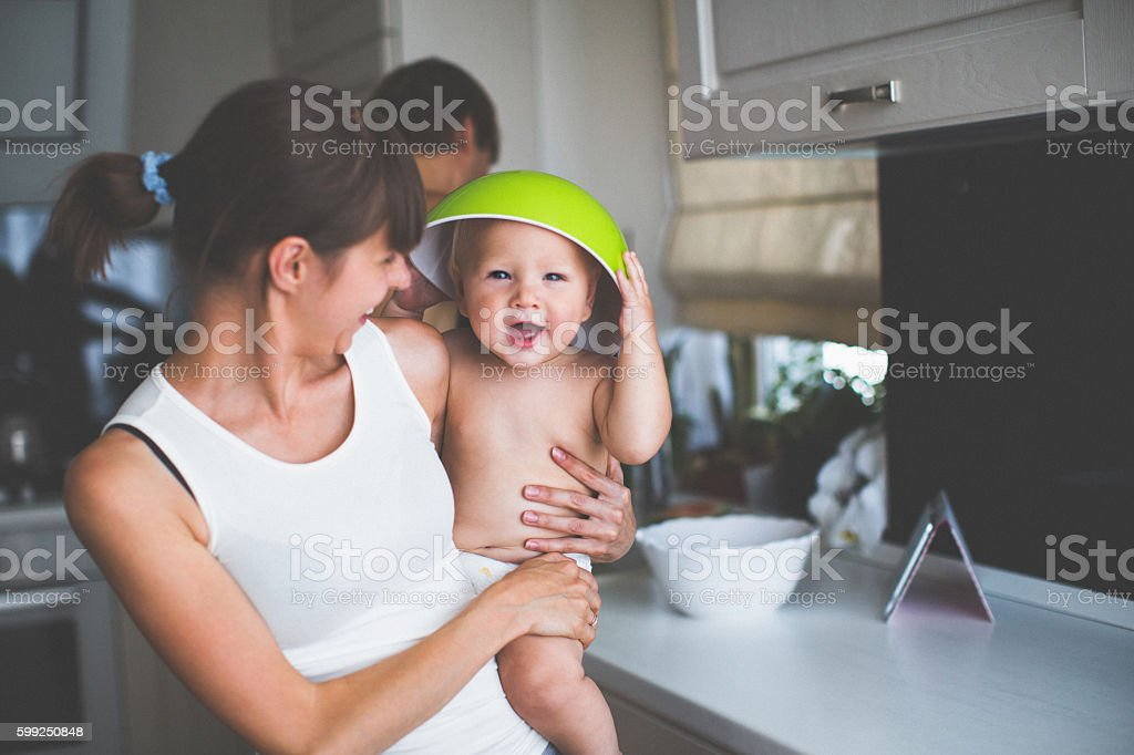 Mother with a child on hands stock photo