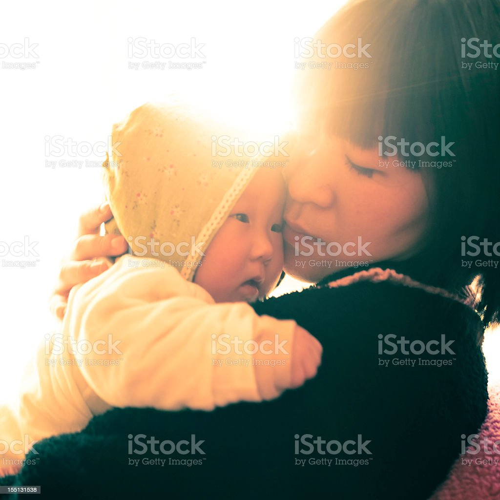 mother with a newborn in sunshine royalty-free stock photo