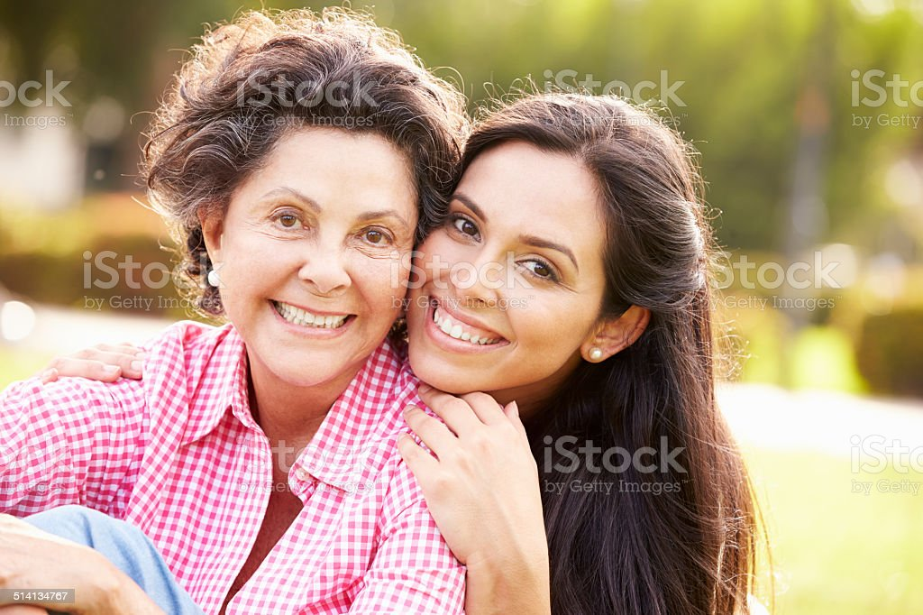 Mother With Adult Daughter In Park Together royalty-free stock photo